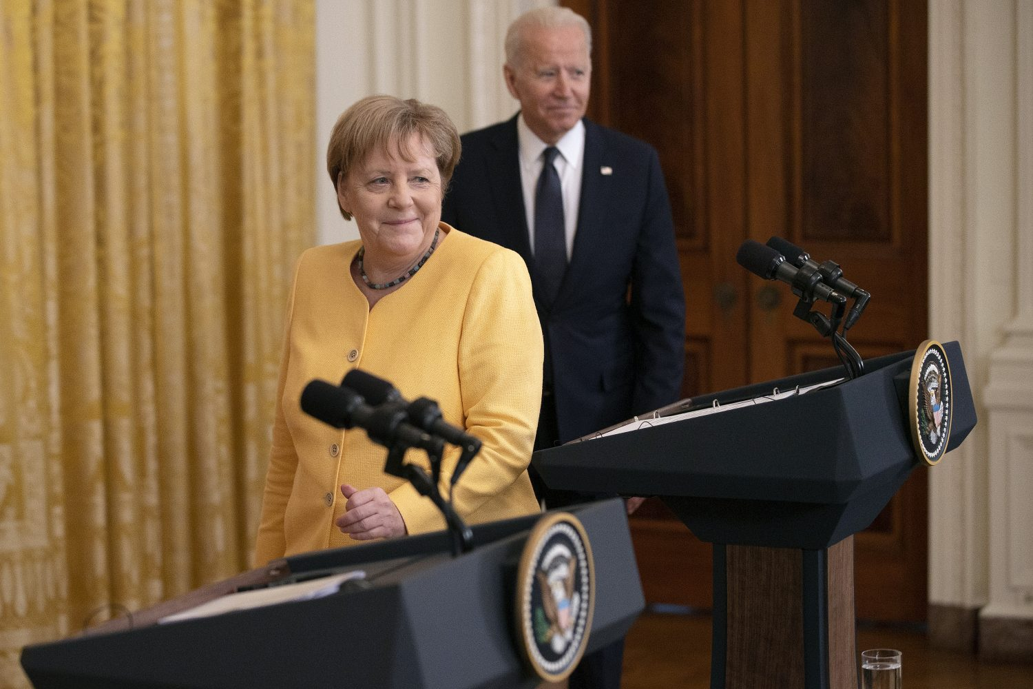 German Chancellor Angela Merkel and U.S. President Joe Biden take the stage for a joint news conference in the East Room of the White House in Washington on July 15.