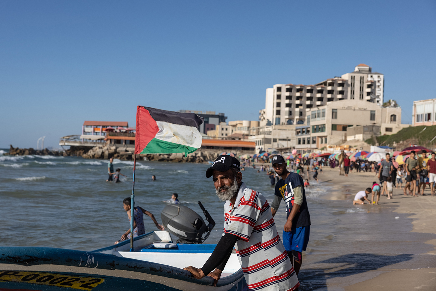 People line Gaza Beach on June 17. Since the 2007-imposed blockade, Gazans have almost no chance of leaving the small enclave.