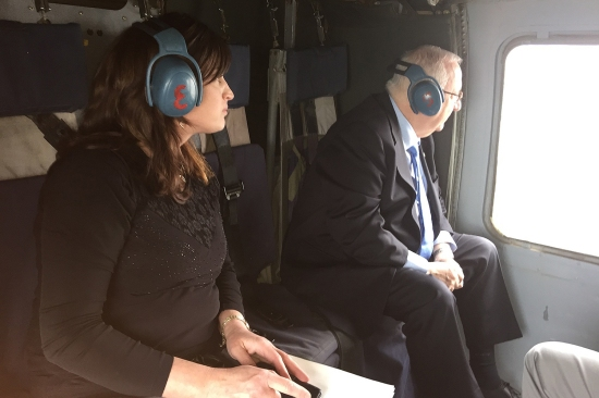 Rivka Ravitz and Israeli President Reuven Rivlin ride in a helicopter
