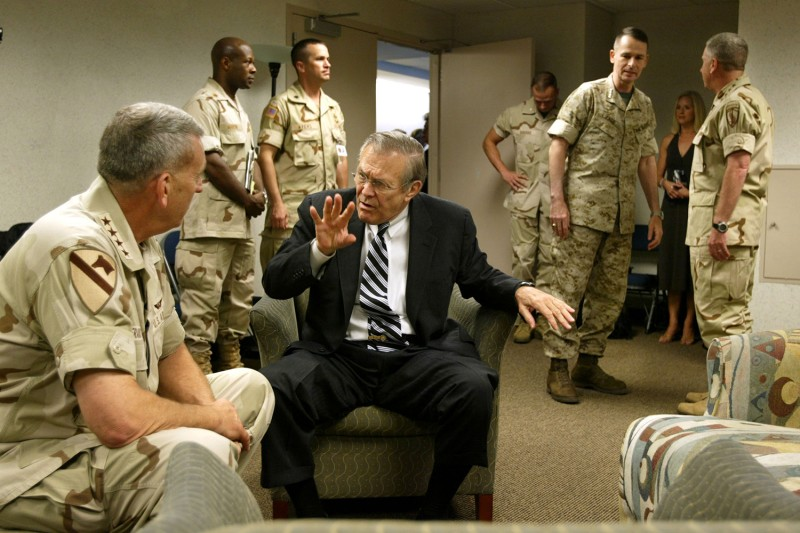 Secretary of Defense Donald Rumsfeld meets with retiring commander of CENTCOM Gen. Tommy Franks (left) in Tampa, Florida, on July 7, 2003.