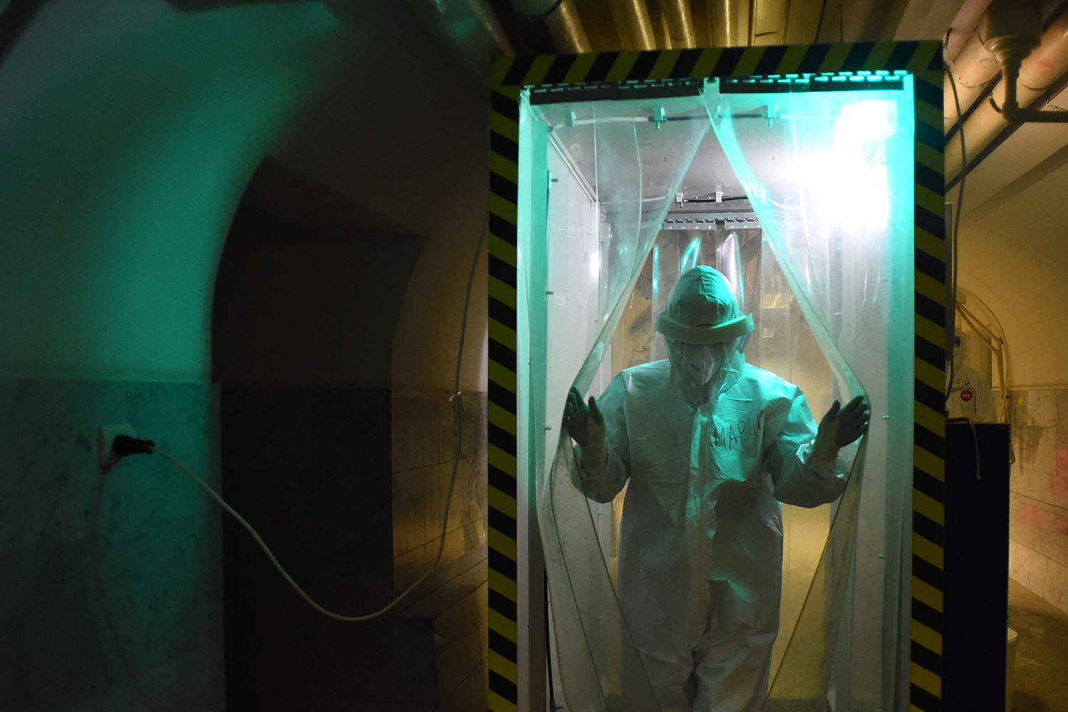 Medical worker in disinfection cabin in Russia