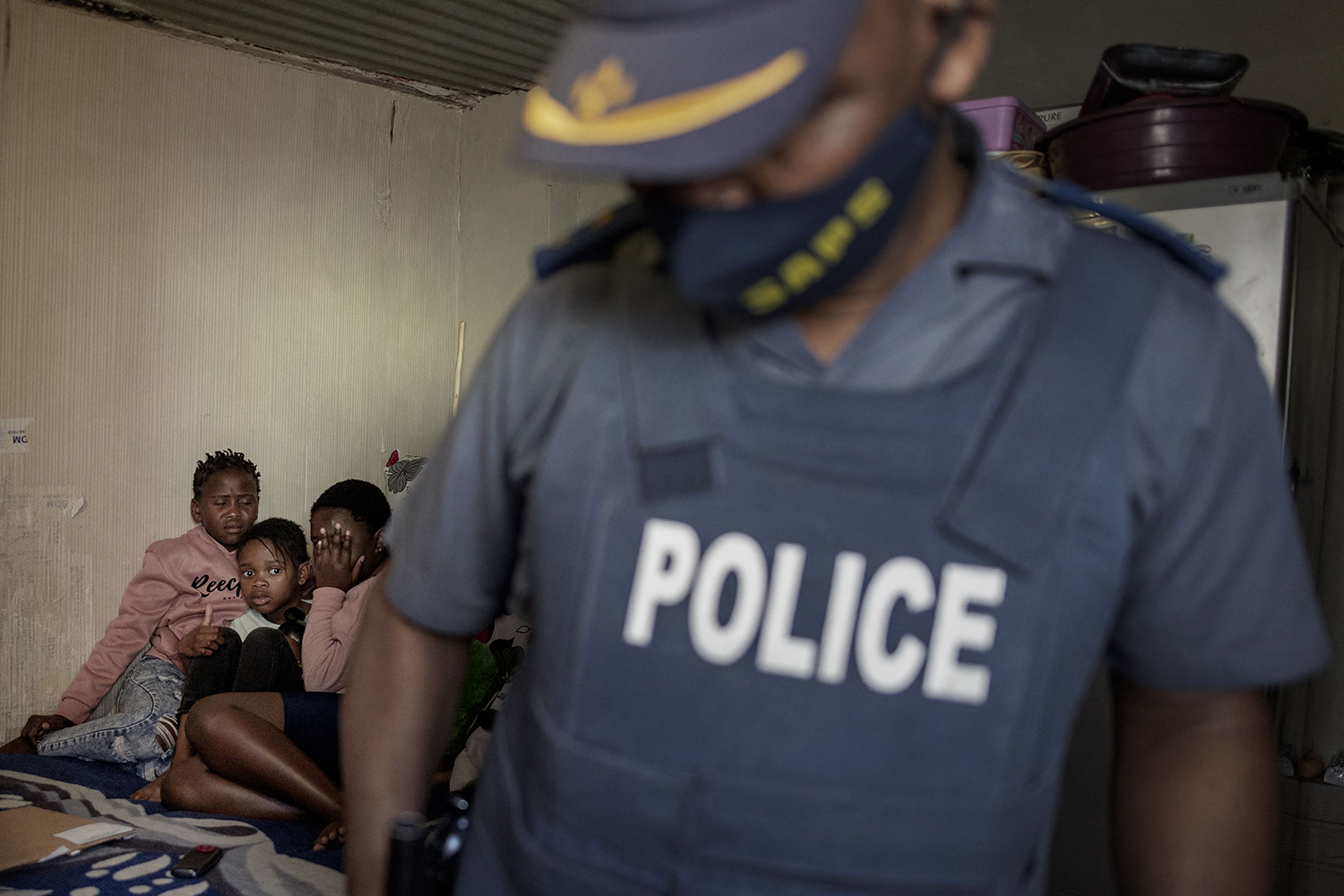 South Africa police search home of suspected looter