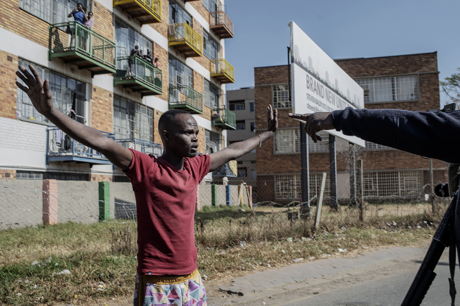 Protester raises hands against South Africa police