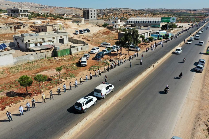 Workers call for humanitarian aid to Syria.