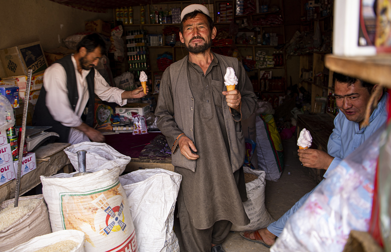 Men eat ice cream at a shop in Saighan district three days after Taliban's retreat on July 21.