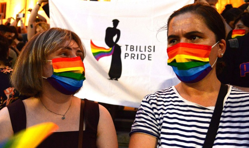 People wear rainbow masks at a rally in Tbilisi, Georgia.