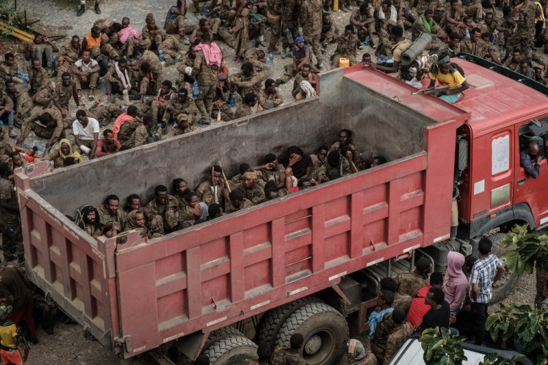 Wounded captive Ethiopian soldiers arrive on a truck at the Mekele Rehabilitation Center in Mekele, Ethiopia, on July 2.