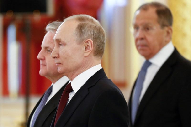 Russian President Vladimir Putin stands with U.S. ambassador to Russia John Sullivan in Moscow.