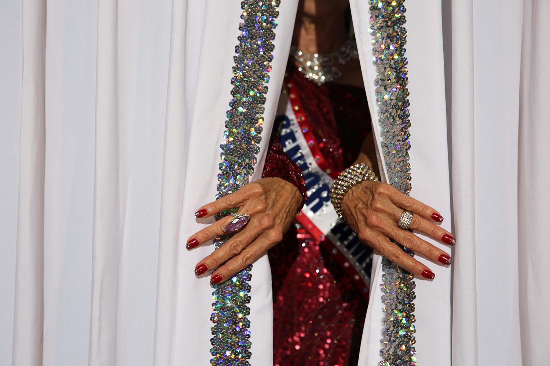 Former Ms. Senior America peeks through curtains