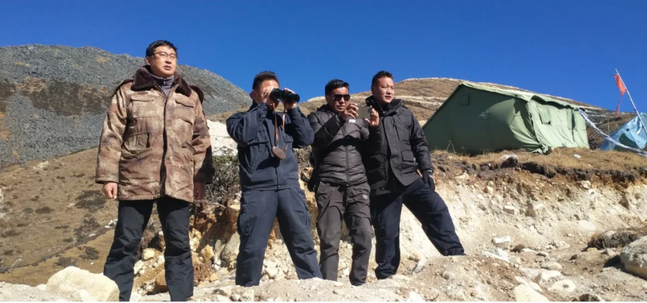 """Zhao (left), the Lhodrak party secretary, with a team of border police at a security post near Dermalung, one of the villages constructed within the Beyul, on Dec. 16, 2020.<span class=""""attribution""""> Hidden Lhodrak/WeChat channel of the Lhodrak County Party Committee Office via the National Security Office of the County Party Committee</span>"""