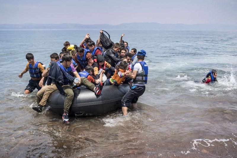 Afghan refugees arrive in Greece.