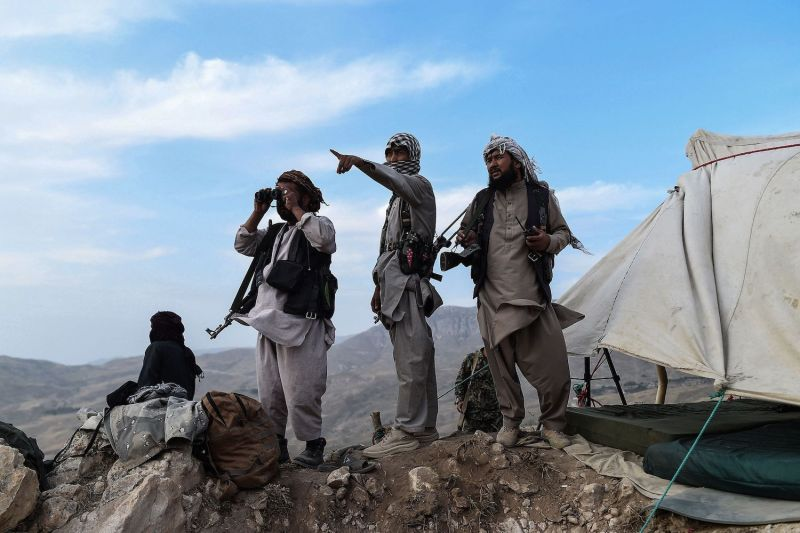 Afghan militia fighters keep a watch at an outpost against Taliban insurgents in Charkint, Balkh province, Afghanistan, on July 15.