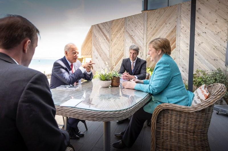 Merkel and Biden talk at G-7 summit.