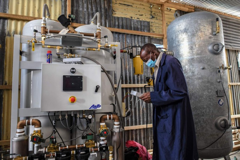 A technician installs the final phase of a domestic oxygen plant at Metropolitan Hospital in Nairobi.
