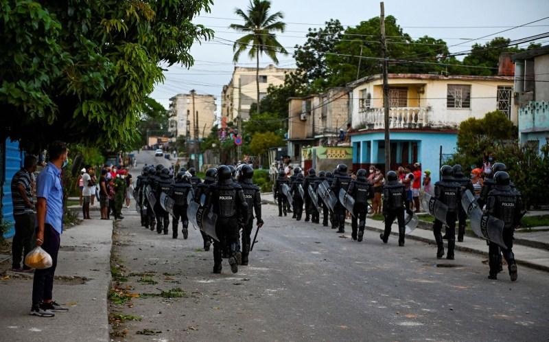 Riot police patrol Havana, Cuba, after a demonstration.