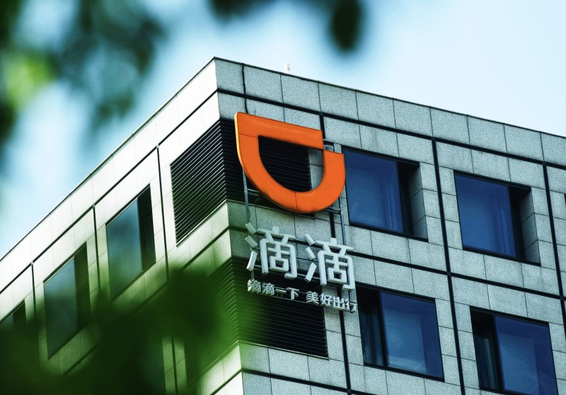 Ride-hailing app Didi Chuxing's logo is shown on a building in Hangzhou, China, on Sept. 4, 2018.