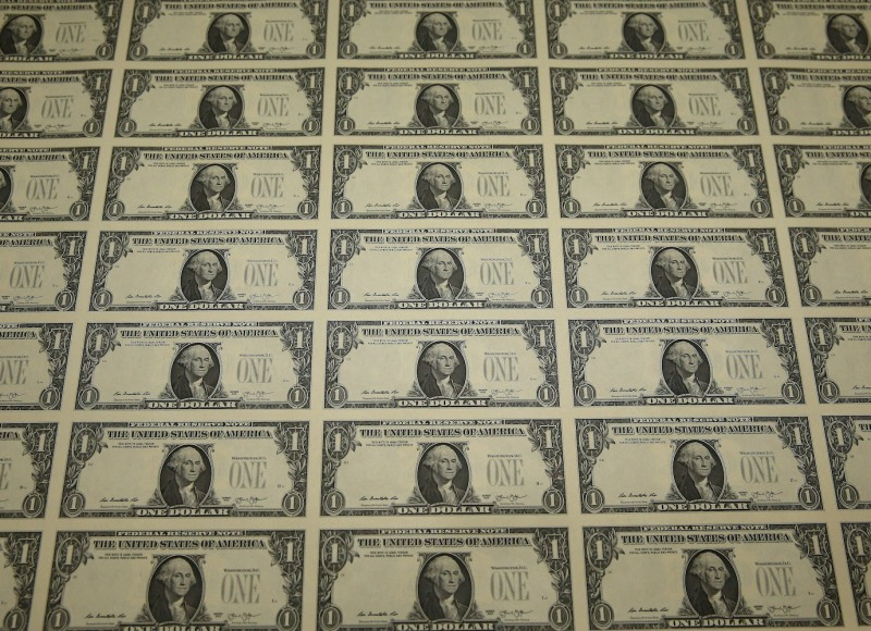 A sheet of freshly printed one-dollar bills lies ready for inspection at the Bureau of Engraving and Printing in Washington on March 24, 2015.