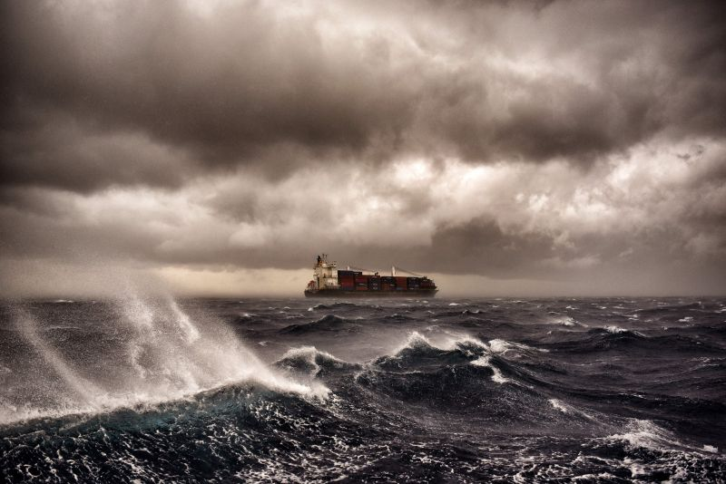 A container ship sails on the Mediterranean Sea during a thunderstorm about 20 nautical miles from Malta on Sept. 24, 2017.