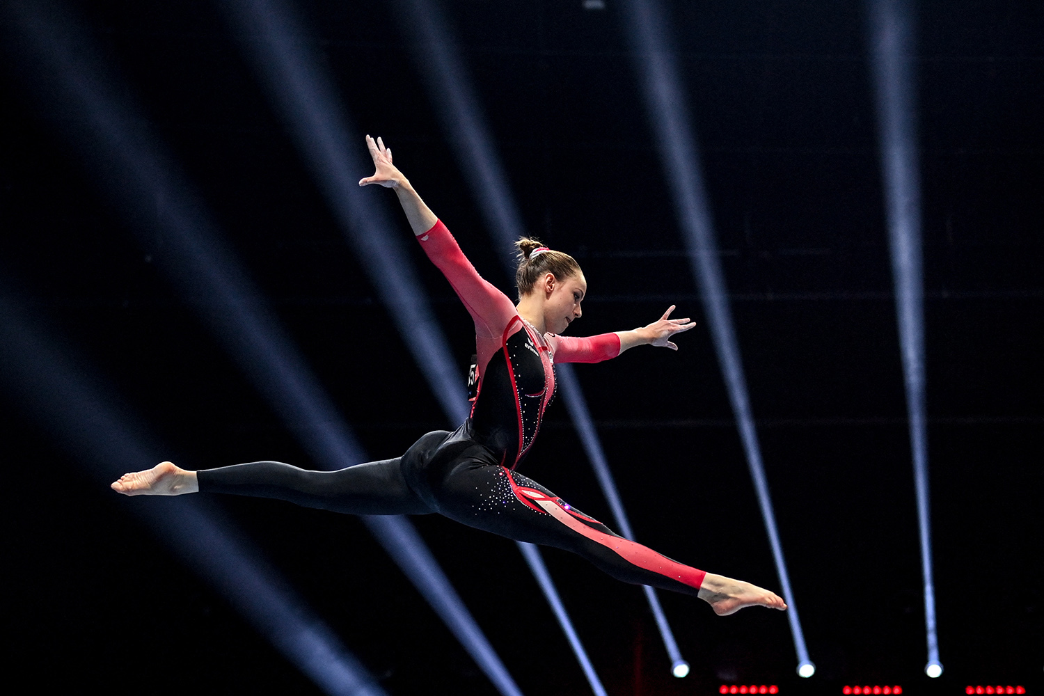 Germany's Sarah Voss wears a full bodysuit while competing in the women's beam qualifications during European Artistic Gymnastics Championships in Basel, on April 21.