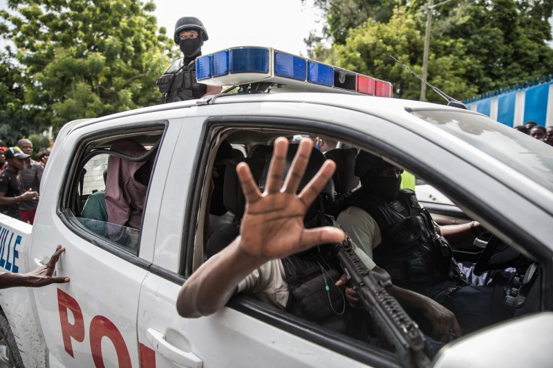 Men suspected in the assassination of Haitian President Jovenel Moïse in a police car