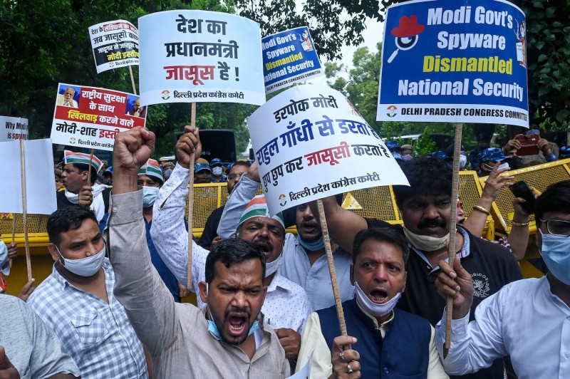 Workers protest Indian government's spyware operation.