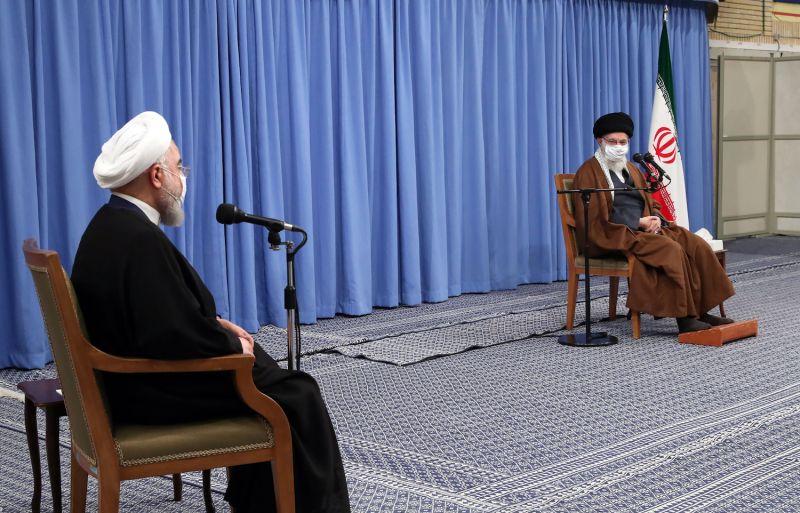 Iran's Supreme Leader Ali Khamenei gives a speech as President Hassan Rouhani listens
