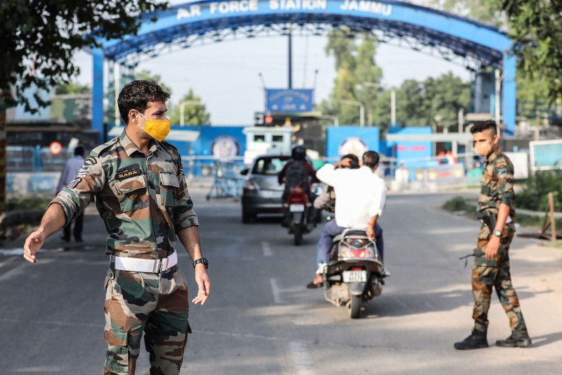 An Indian air force officer gestures as he stands guard outside the Jammu Air Force Station entry gate in Jammu, Indian-administered Kashmir, on June 27.