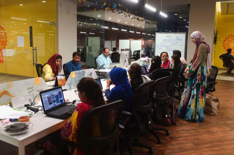 People work at the National Incubation Center, a start-up incubator in Lahore, Pakistan, on May 24, 2019.
