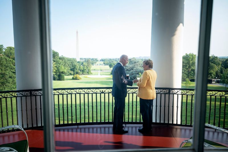 German Chancellor Angela Merkel and U.S. President Joe Biden stand in the White House with a view of the Washington Monument on July 15.