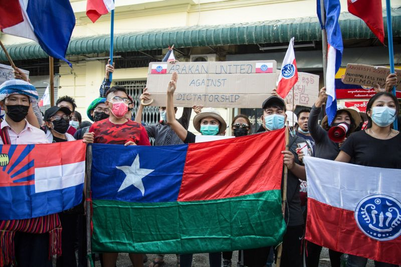 Arakan protesters hold banners and flags during an anti-coup protest in Yangon, Myanmar.