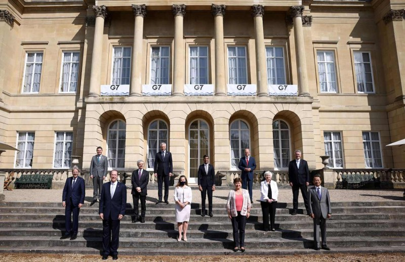 EU, World Bank, and IMF representatives pose with G-7 finance ministers ahead of a meeting to decide on the path forward for a global minimum tax rate in London.