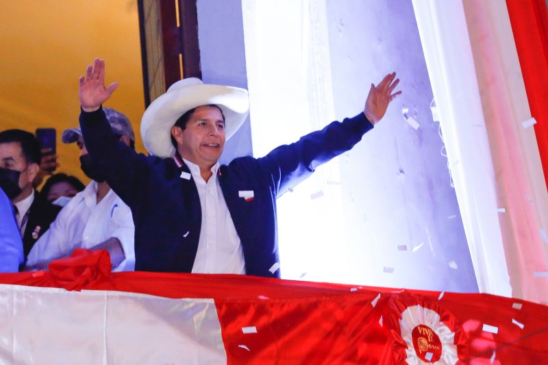 Newly Elected President of Peru Pedro Castillo waves supporters during a celebration after being confirmed as new president of Peru at the campaign headquarters on July 19, 2021 in Lima, Peru.
