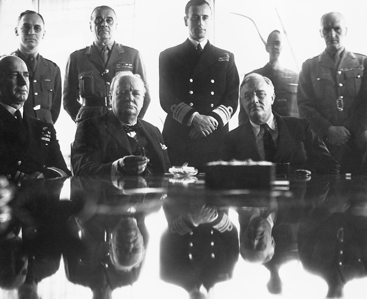 An allies grand-strategy conference in North Africa includes Roosevelt and Britain's Winston Churchill (center left, seated_) in 1943.