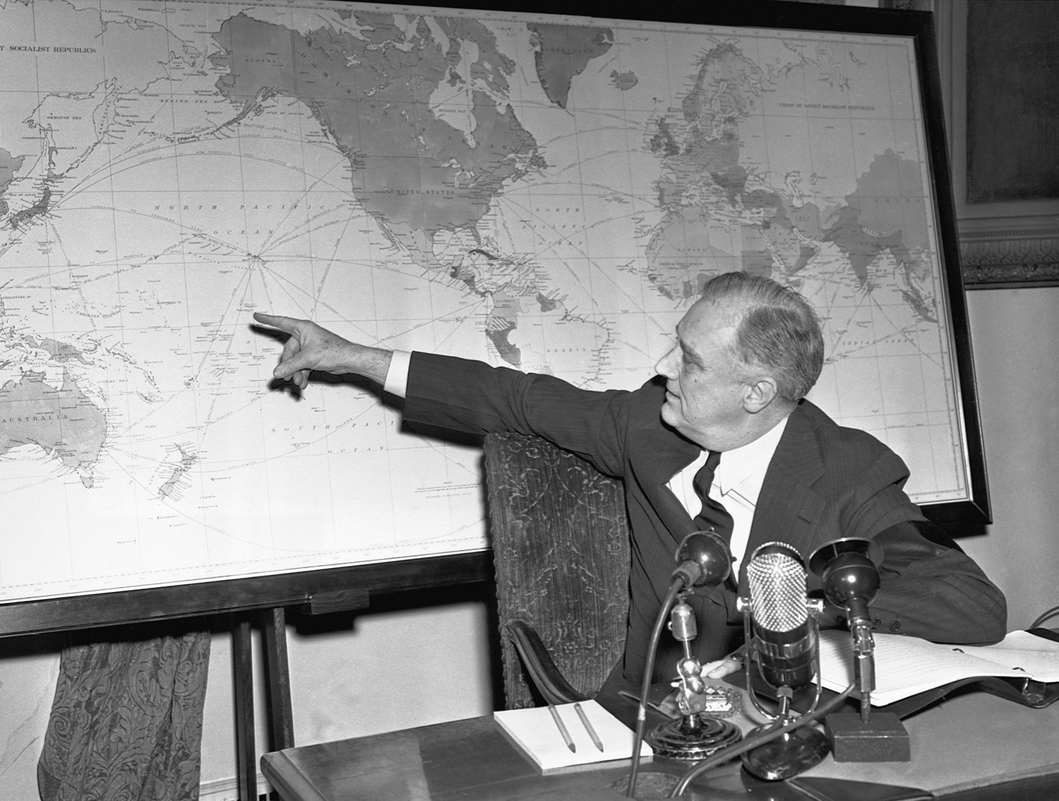 """Roosevelt speaks from. the Oval Office of the White House on Feb. 23, 1942, during a """"fireside chat."""" in which he warns that the United States, scorning a """"turtle policy"""" of """"not sticking our necks out, will carry the war to the enemy."""""""