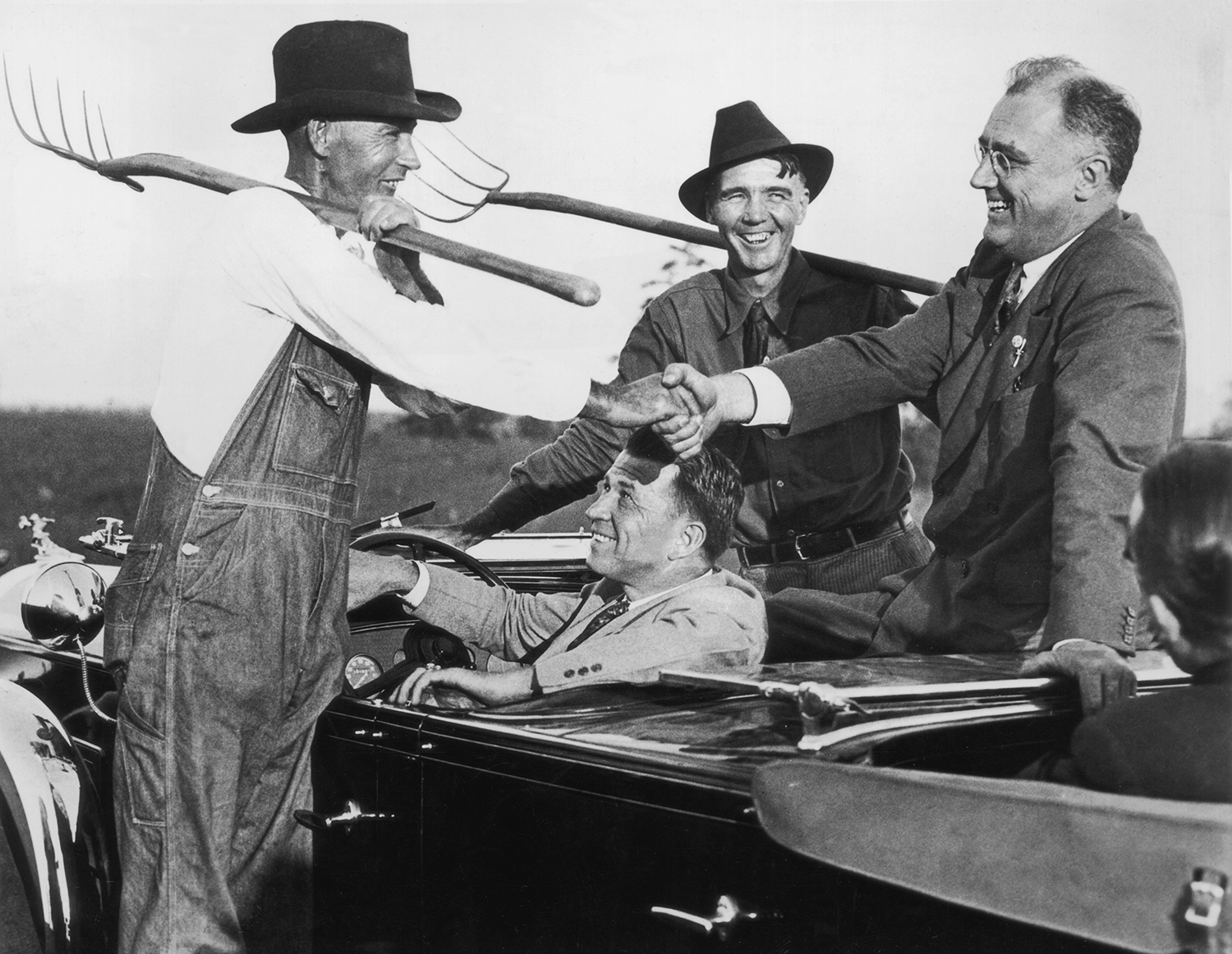 Roosevelt talks with two Georgia farmers in the year he was elected president in 1932.