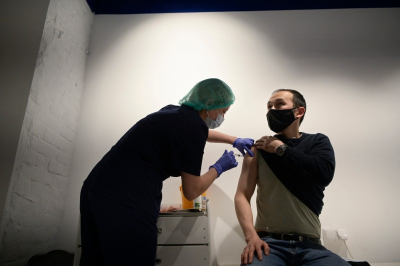A Russian healthcare worker administers a dose of Sputnik V vaccine at a vaccination center in the GUM department store in Moscow on July 2.