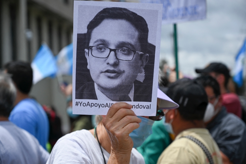 A demonstrator holds a portrait of the dismissed Guatemalan anti-corruption prosecutor Juan Francisco Sandoval during a protest in Guatemala City on July 24.
