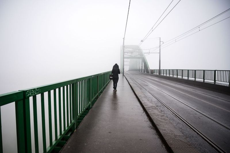 A pedestrian walks over a bridge in Belgrade as heavy fog and air pollution dominate the sky over the Serbian capital Belgrade on Jan. 16, 2020.