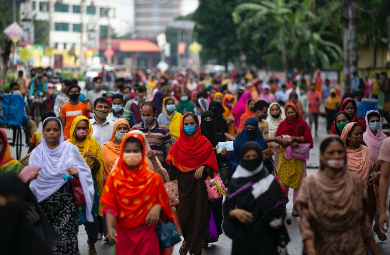 Garment workers walk to work at their factories during a countrywide lockdown to contain the spread of COVID-19 in Dhaka, Bangladesh, on July 5.