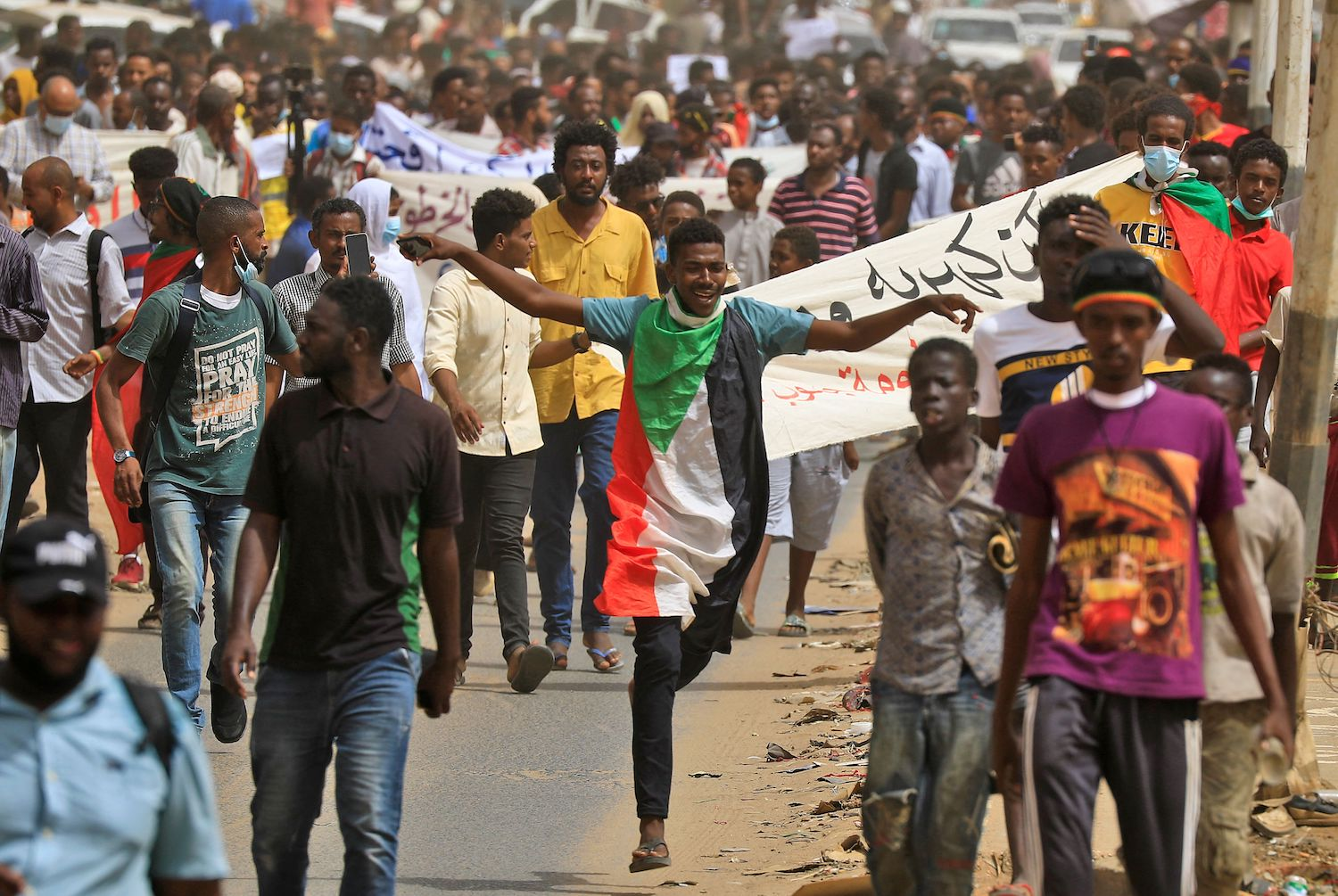 Sudanese protesters participate in a march urging the government to step down over delayed justice and recent economic reforms in Khartoum, Sudan, on June 30.