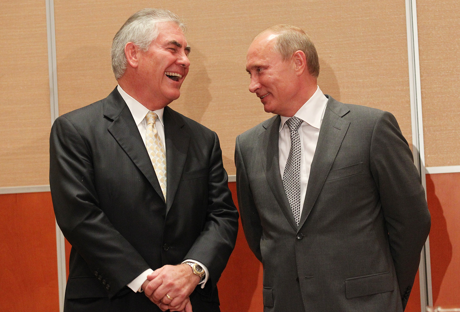Russian President Vladimir Putin and Rex Tillerson, then-chairman and CEO of Exxon Mobil, attend a signing ceremony for an Arctic oil exploration deal between Exxon and Rosneft in Sochi, Russia, on Aug. 30, 2011.