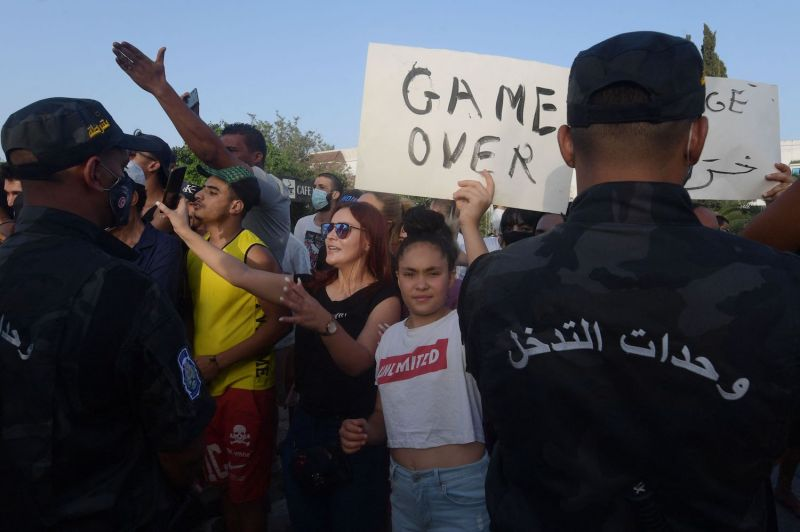 Supporters of Tunisian President Kais Saied chant slogans denouncing Assembly Speaker and Islamist Ennahda party leader Rached Ghannouchi in front of the Tunisian parliament in Tunis on July 26.