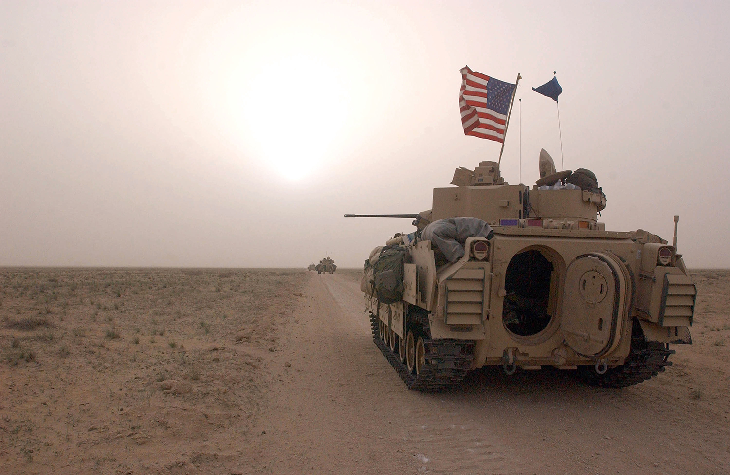 U.S. Army 3rd Division Bradley fighting vehicles take up a position along a road inside the demilitarized zone between Kuwait and Iraq on March 19, 2003, ahead of the invasion of Iraq.