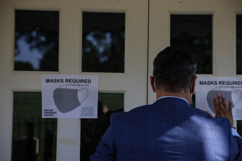 Signs for mask-wearing guidance at the White House
