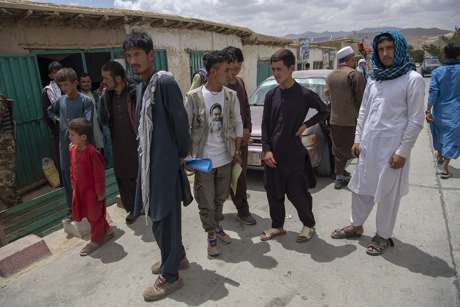 Men and boys stand in the street in Saighan district on July 21.
