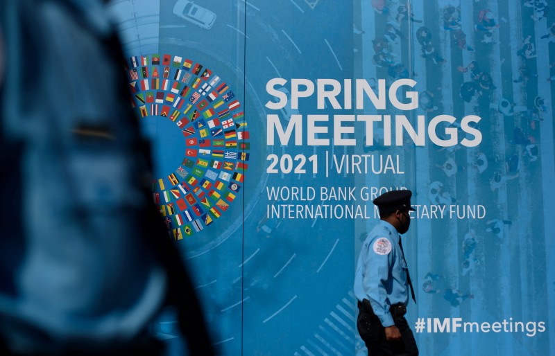 A security guard walks through the headquarters of the International Monetary Fund in Washington on April 5.