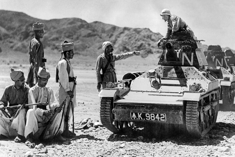 British soldiers in tanks pass an Afghan guard post in 1941.