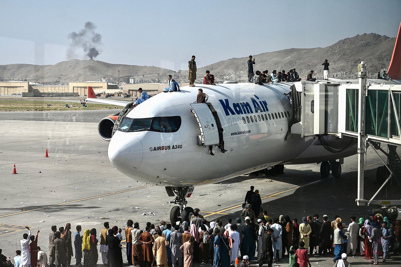 Kabul airport plane evacuates