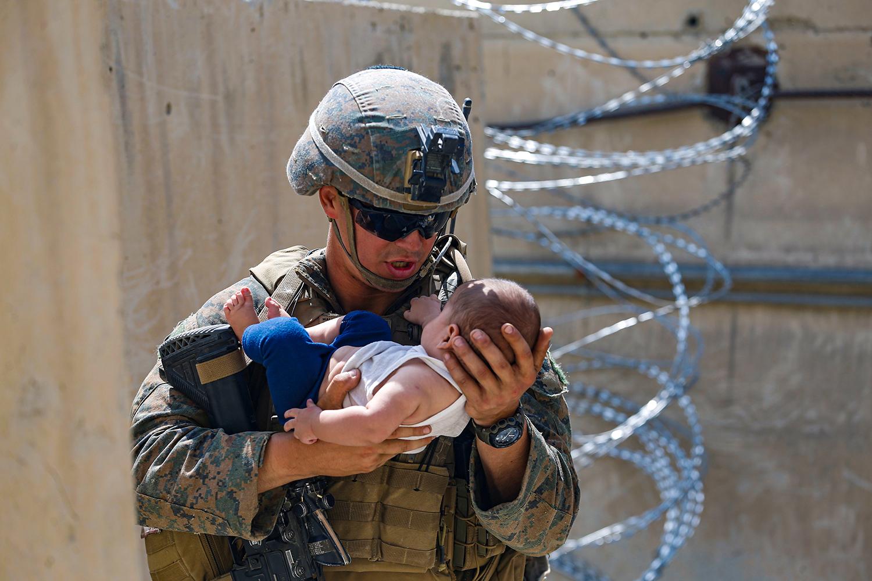 Marine holds baby in Kabul