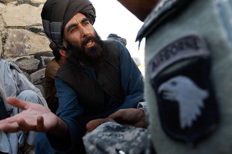 An Afghan Pashtun tribal elder speaks to an interpreter.